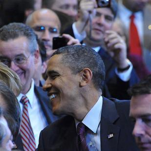 A crowd surrounds President Obama during his visit to a GE plant in Schenectady.