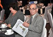 More than 350 people attended the dinner. Here, one attendee reads through The Business Review publication featuring the 2012 Achievers.