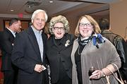 An unidentified woman, right, poses for the camera with Jan Smith, center, a former General Electric spokeswoman and principal of Castle Rock Ranch Group, and Joseph Gersuk, CFO of the Latham-based AngioDynamics. Angio, a medical device manufacturer, won the Company of the Year honors.
