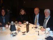 Capital Financial Planning employees attend an awards banquet.