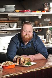 Ian Brower, chef at Capital City Gastropub in Albany, with(right)Northeast Family Farm roasted marrow bones with capers, parsley and horseradish, and a sidedish of turnips and almonds.