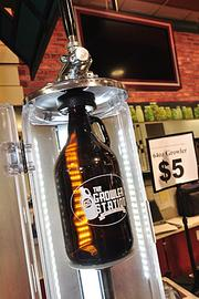 A refillable, 32-ounce glass bottle, or growler, costs $4, while a 64-ounce costs $5.