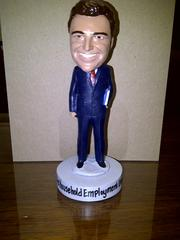A bobblehead of the boss: Guy Maddalone, CEO of GTM Payroll Services.