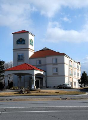 The La Quinta Inn & Suites in Latham, one of two hotels put up for sale by Rocky Cocca to satisfy the estate of his deceased business partner.