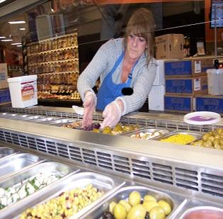 Theresa Smith prepares the salad bar at the ShopRite opening April 26 at 709 Central Ave. in Albany. Smith is a sales rep at RDD Associates, a food broker in Totowa, New Jersey