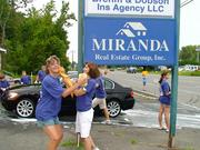 Miranda Real Estate workers fool around during a car wash.