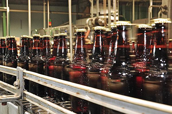 Bottles on the conveyor belt at Olde Saratoga Brewing Co. in Saratoga Springs