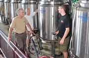 CH Evans Brewing/Albany Pump Station owner Neil Evans (from left), his brother, Roland Evans and brewer Ryan Demler.