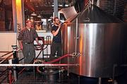 Peter Martin (left) director of brewing operations at Brown's Brewing Co., and brewer Dan Cramer at the Troy brewery's mash tun equipment.