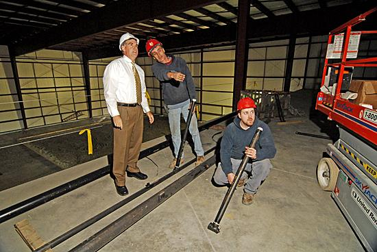 Joseph Fairley, left, managing partner of Extra Innings, at the  construction of his indoor sports training facility in a Ballston Spa in  2007. The business filed for bankruptcy in September, leaving the site open for F.W. Webb Co.'s expansion.