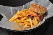 The elk burger and seasoned fries from Dave's Pizza and Exotic Burgers in Albany.