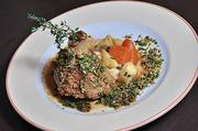 A plate of pork osso buco with chive truffle gremolota and braised root vegetables prepared at Max London's Bar + Grill in Saratoga Springs.