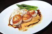 mio posto in Saratoga Springs serves this dish of pan seared scallops, blood orange burro, butternut squash risotto and asparagus.