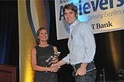 The Business Review's publisher, Carolyn M. Jones, gives Eben Bayer, CEO of Ecovative Design, the Newcomer of the Year award at the Nov. 10 Achievers award ceremony.