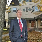 Dan Nolan, chairman of The College of Saint Rose board of trustees, outside a Victorian that's being renovated for the School of Business.
