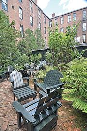 The courtyard of the Adelphi Hotel at 365 Broadway. Open to guests and non-guests alike, this is a place to put your feet up, enjoy the greenery and perhaps order a drink.