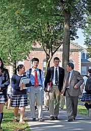 Head of schools Douglas North talks with students at The Albany Academies.