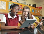 Sabine Stain, left, and Allayla Silipigno work with iPads at Albany Academy for Girls.