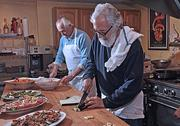 Jim Rua, foreground, chef/owner of Cafe Capriccio, and Joe Messina of Amici Vineyard in Washington County. Rua doesn't offer coupons or online promotions, but does support Albany restaurant weeks.