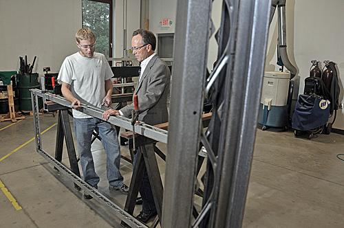 From left, Todd Borden, head of metal production, and Russ Brooks, principal of Case Window and Door, a Green Island window-frame manufacturer.