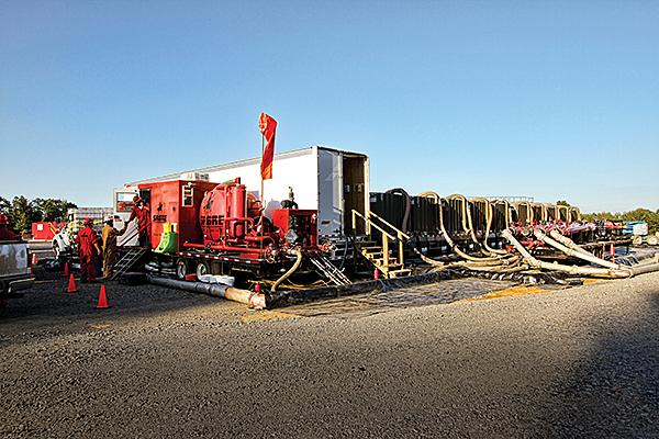 Sabre Technical Services LLC, of Slingerlands, N.Y., operates five $1 million rigs that purify water contaminated by hydrofracking. This crew is shown at a drilling site in Arkansas.