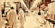 Workers inside a GlobalFoundries cleanroom in Malta. A $2.3 billion expansion will add more manufacturing space as the popularity of mobile devices increase the demand for chips.