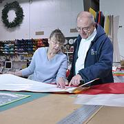"""I'm hoping the tax cap forces everyone to the table,"" says Michael Cronin, president of Gettysburg Flag Works. ""There has to be something we can do."" Here, Cronin talks shop with employee Kathy Popp."