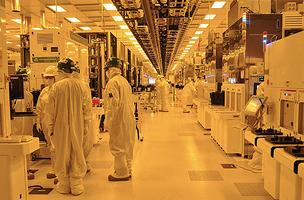 Engineers and technicians at GlobalFoundries in Malta are working to increase production as the company borrows $1 billion to expand capacity at its plant in Dresden, Germany.