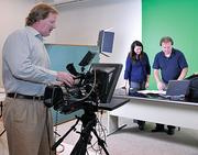GlobalSpec employees demonstrate the company's virtual trade show business in a file photo from 2010. From left are Jim Bittel, Amber Devin and Rich Northrup.