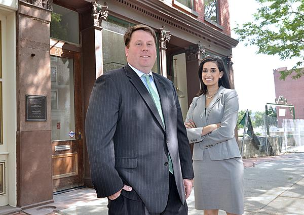 Gramercy Communications President Thomas Nardacci and public relations manager Veronica Nunes outside the company's new location in Troy.