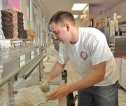 Dan Guptill, co-owner of Guptill's Coney Express, serves ice cream for a customer. Guptill's placed fourth on the list.