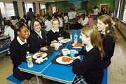President Eva Joseph joins students for lunch at the Academy of the Holy Names in Albany.