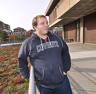 Rensselaer student Kyle Mattson already has at least five job offers. Here, he shows off a green rooftop on the Troy campus.