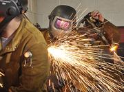 Charlie Cooper welds during class at the Modern Welding School in Schenectady. GE recruited at least 10 graduates last fall to work at its new $100 million battery manufacturing plant, also in Schenectady.