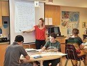 Teacher Leah Blind leads her eighth grade math class at Woodland Hill.