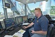 New Castle Asphalt plant supervisor Gene Kluck works the control tower.