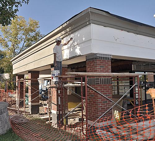 Dan Duncan, of Wainschaf Associates, works on exterior renovations at Berkshire Bank Plaza in Latham. The shopping center is among several in the region being remodeled.