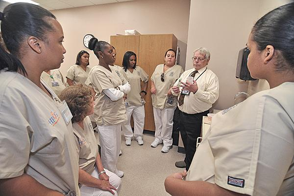 At Schenectady County Community College's Center City location, instructor William Rowe teaches a health professions class. Since fall of 2011, 600 more students have taken classes at the Center City site, prompting the school to expand there.