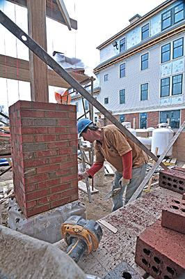 Ron Lewis of MVP Construction Co. is at work in the courtyard as Centennial Hall is built on The College of Saint Rose campus. The $17.5 million project on Madison Avenue in Albany is transforming the streetscape in this Pine Hills neighborhood.
