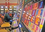 Playing at one of the video lottery terminals at the Saratoga Casino and Raceway, also known as the Racino.
