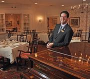 Scrimshaw dining room manager Frank Rivera. The restaurant is noted for its crisp white linens, elegant tableware and fine crystal.