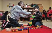 Tyrese Myles, left, and Josh Alpas build with Legos at Sheridan Preparatory Academy in Albany in the school's pre-K program.