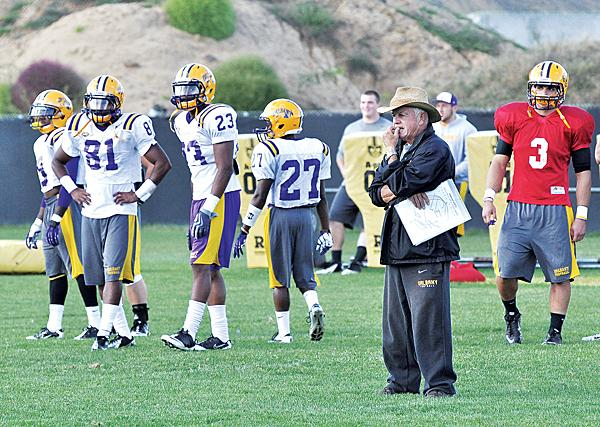 On the field during practice at the University at Albany. Coach Bob Ford, right, in his 43rd season, is taking the team to a tougher conference next year.