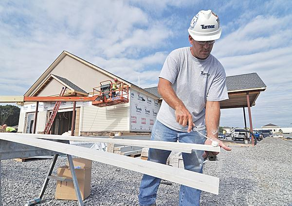 Brendan Farrell of C&S Siding-Stackewicz Inc. works on the Berkshire Bank building that is among several businesses going into the Vista Technology Campus in Slingerlands.