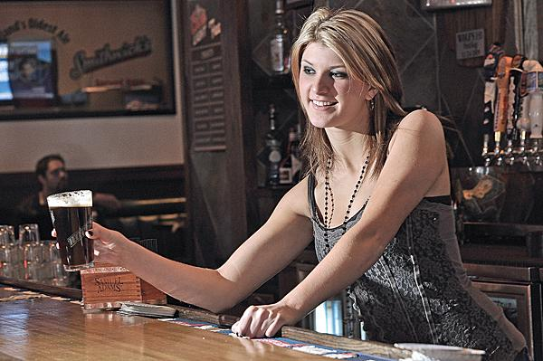 Wolf's 1-11 bartender Aubrey Hunt serves a pint of Ubu ale, one of the labels produced by Lake Placid Craft Brewing Co.