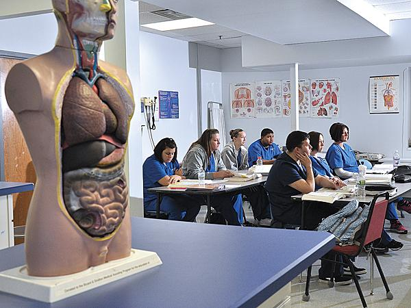 The demand for health care programs is driving Bryant & Stratton's decision to invest $500,000 into an expansion on Wolf Road in Colonie that will house the school's medical programs. Pictured above, students in a Bryant & Stratton clinical procedures class at the Central Avenue campus.