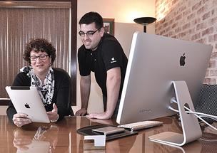 Amy Johnson, president of Capstone Inc., a Latham tech recruiting company, was one of the earliest employees to work for Apple. Still, Johnson said her recruiting business relied on Microsoft products until recently, when her children told her what she was missing. Johnson, in the photo above, talks with James Hardesty, a member of the Apple business team.