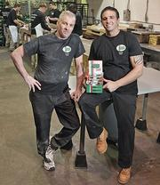 Brothers Joe Alberino, left, and Chris Alberino, owners of The Cookie Factory in Troy, are pursuing a new market, convenience stores, that they expect to boost sales by 10 percent this year.