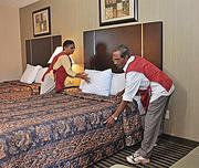 Bhanuben Patel, left, and Ramanlal Patel  make a bed at the Glenmont EconoLodge.