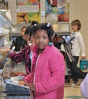 Albany School of Humanities first-grader Makayla Davis waits on line at the school cafeteria. The school is part of the Albany city district.